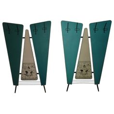 Pair of 1950s wall coat racks by Jeam-Verona. Formica and vinyl upholstery.