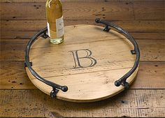 Bring rustic elegance to the table with this personalized wooden lazy Susan edged with iron. Barrel Projects, Diy Wood Projects, Wood Crafts, Diy Lazy Susan, Wine Barrel Furniture, Wooden Wreaths, Wood Tray, Diy Signs, Wooden Diy