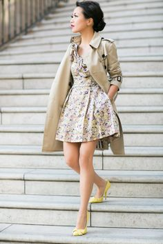 Floral dress, beige trench, yellow bow shoes.