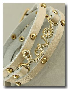 Crystal love and leather adjustable bracelet wraps around your wrist multiple times for a beautiful look.
