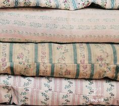 stack of old ticking pillows