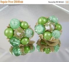 These earrings are just lovely. Goldtone and various shades of green beads are set in an ornate goldtone setting.  A great addition to your #vintage collection!   Size:  1... #ecochic #etsy #jewelry #jewellery #holiday2014etfs