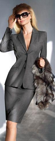 Uber feminine business suit with faux fur & sunglasses. NOTE: sunglasses