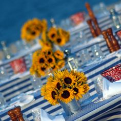 Love the sunflowers in silver cans for a summery centerpiece! #Entertaining #Summer
