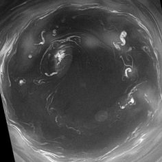 Saturn's south polar vortex-  A monstrous vortex sits at Saturn's south pole. It's not just beautiful. It also lets astronomers peer deep into Saturn's dense atmosphere: NASA/JPL/Space Science Institute