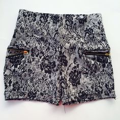 """High waist shorts Lace patterned pull on high waist shorts . With pockets and zipper for styling . 65% cotton 30% nylon 5% spandex. Price is firm unless bundled. Tag says l/Xl. Waist lying flat 13"""" hips 15.5"""" length 13.5 inseam 2"""" Unbranded Shorts"""