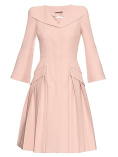Princess Madeleine´s open-neck pleated coat from Alexander McQueen.