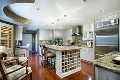 Granite countertops, stainless steel appliances, island woodblock and a wine storage area are just a few of touches that make this McCormick Ranch kitchen truly stunning.
