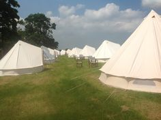 Bell tent village just outside Ilkley, Yorkshire. Glamping for all the wedding guests on a scorching weekend.