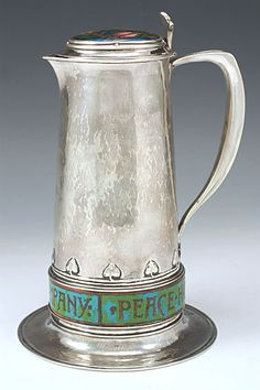 Very rare Arts & Crafts sterling silver jug with enamel lid. The collar towards the base of the jug is enamel on copper.