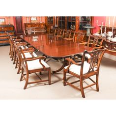 An elegant dining set comprising an antique George III dining table and a fabulous set of 10 Chippendale Revival armchairs.