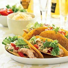 Easy Rotisserie Chicken Recipes: Spicy Chicken Tacos (via Parents.com) use to get rid of leftover chicken