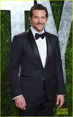 Bradley Cooper in a midnight blue shawl tuxedo with black lapels.