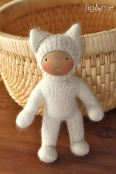 made from old socks - love the wideset eyes and cute cat costume :) great way to repurpose soft socks...