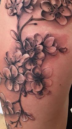 Cherry blossom on thigh in black and grey - by Nico Dray (The Worlds End) in Gue. - Cherry blossom on thigh in black and grey – by Nico Dray (The Worlds End) in Guernsey. Up Tattoos, Body Art Tattoos, Sleeve Tattoos, Crow Tattoos, Phoenix Tattoos, Circle Tattoos, Wrist Tattoos, Tattoo Ink, Tatoos