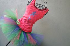 Running Tutu: Disney Princess Half Inspired Custom Pink Ariel Racing Tank and Pixie Length (9 inch) Tutu. $60.00, via Etsy.