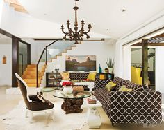 Marc & Melissa Palazzo, California home, living room, LuluDK chant, brown, white cowhides, chandelier, root table