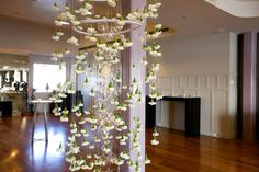 A floor to ceiling flower chandelier created entirely of white sim carnations suspended from satin ribbons in the centre of Harbour Room's dancefloor. Flowers and Styling by Victoria Whitelaw Beautiful Flowers.