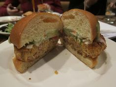Three Grain Veggie Burger from Common Ground in Allston, Mass. Made with white beans, lentils, and chickpeas, and topped with fresh tomato & cucumber fennel relish, as well as tarragon mayonnaise. #vegetarian