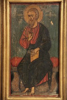 """Palestinian-Christian Icons of Saints Luke, Apostle and Evangelists rendered in the Greek Orthodox style with Late Byzantine influences, painted pine panel, late 18th to early 19th c, depicted enthroned, with haloe, his name in Greek, housed in later gold molded box frames, OS: 20"""" x 12"""", SS: 17 1/4"""" x 9 1/4""""."""