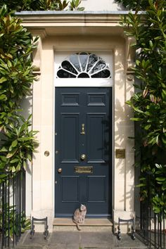 from Modern Country Style blog: Beautiful Farrow and Ball Front Doors...color: Railing