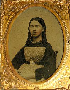 Civil War era ambrotype, unusual printed apron and wearing belt around outisde of apron.