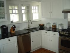 white beadboard backsplash. we already have white cabinets and will install new black countertops