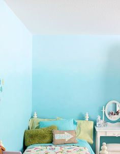 How-to ombre walls. 2 paint colors. Paint top 1/3 of wall in lighter shade, paint bottom 1/3 on darker shade, mix 2 shades together  paint middle 1/3 with mixed color, blend thirds using up  down and cross-hatch brushstrokes.