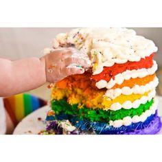 My daughter smashing the rainbow cake.