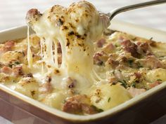 Tartiflette- A luxurious potato dish from the French Alps made with melted cheese, lardons (French bacon), and onions.