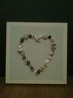 My second shell art panel completed yesterday on a rainy afternoon. 30cm x 30cm wrapped in natural calico fabric with shells lovingly individually affixed in 'heart' outline design.   All shells sourced locally (North Devon).   Checkout my facebook page for more items: Jessica Walker -Handmade with Love