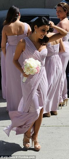 Elegant: Eva was spotted holding onto a nude clutch as well as her gorgeous bouquet of flowers - Bridesmaid Dress