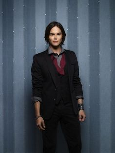 """Caleb looks good in a suit... Click to see more great looks in """"25 Pretty Little Liar Fashions We Envy"""" on BuzzFeed!"""