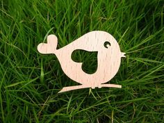 a cute bird on a little branch with a big heart love in it's body wooden brooches