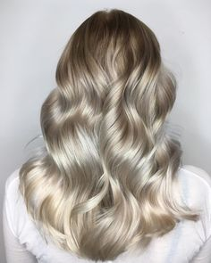 Soft silver tones beautifully blended into pearl blonde. Created by Wella Professional Cecilie.