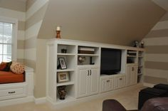 love the stripes and built ins for this bonus room