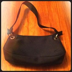 Navy Lacoste bag! Barely used navy Lacoste bag. Bought it in Europe a few years ago. Great small bag Lacoste Bags