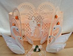 http://forevermemoriesforyou.co.uk/Shop/#  This site has STUNNING electronic cutting files  Template Cascading Wedding Swan Door Card