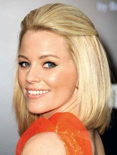 Demonstrating just how versatile the bob can be, Elizabeth Banks sections off her bangs before sweeping them over her crown and pinning at the back of her sleek hairstyle with a single barrette. via @stylelist