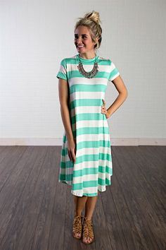 This comfy striped dress pairs perfectly with gladiator sandals for summer! You can dress it up for a BBQ or dress it down for a day at the beach!