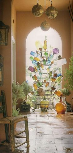 I've always wanted a bottle tree! Love glass and find the concept of a bottle tree so intriguing! Bottles And Jars, Glass Bottles, Bottle Candles, Empty Bottles, Bottle Trees, Tree Shop, Bottle Rack, Big Bottle, Do It Yourself Home