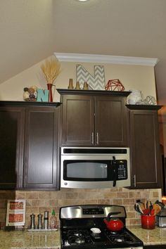 Above cabinet decor on pinterest above kitchen cabinets for Ideas for things to put on top of kitchen cabinets
