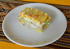 Causa Rellena,mashed potatoes, avocado, peppers, chicken or tuna fish. Visit us at www.cusitravel.com