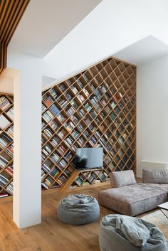 Bookshelf- I would do a fraction of this on a wall with a thick Mantle