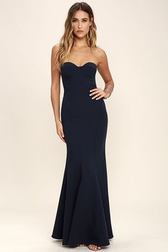 The For Infinity Navy Blue Strapless Maxi Dress will help you have the night you've always dreamed of! Medium-weight knit shapes a strapless, princess seamed bodice with lightly padded cups, hidden boning, and no-slip strips. Flaring mermaid maxi skirt. Hidden back zipper and clasp.