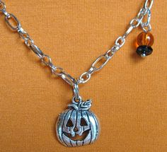Jack-O-Lantern necklace, because it's never too early for Halloween!! $17.00.  Really cute.