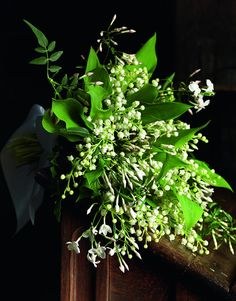 """Think about using shades of the same color. """"The human brain is slow to process color,"""" says Connolly. """"It is easily confused."""" Shown here: a classic combination of lily-of-the-valley and jasmine."""