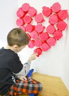 This DIY bursting hearts game is a fun idea for your kids for Valentine's Day.