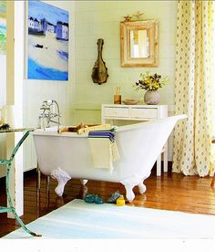 Beautiful tub and wooden floors