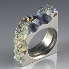 stefan alexandres - This Unique art ring is made of Reclaimed Anodized Titanium, 10K Yellow Gold, Blue Sapphire accent.